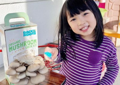 Little girl with Back to the Roots mushroom kit