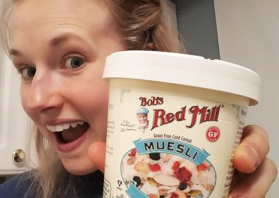 Girl trying Bob's Red Mill